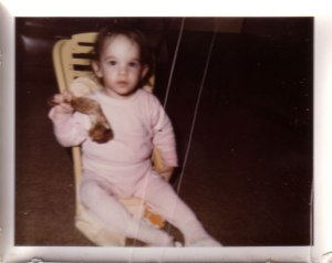 Me, as a toddler, eating a huge chicken leg!