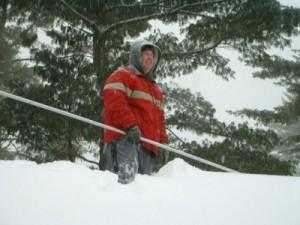 Ken shoveling our roof in Massachusetts, December 2002.