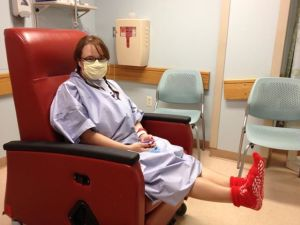 Moments before surgery, smiling behind my surgical mask. This surgery was an investment in my future health.