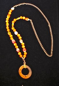 Carnelian pendant with various stone beads and gold-plated chain.