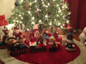 The Misfits watch over the gifts under the tree.
