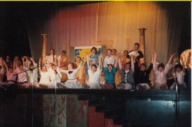 """The King and I"". From the audience perspective, I am in blue (I played a twin) on the right of Anna."